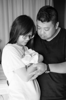 Couple with tiny baby